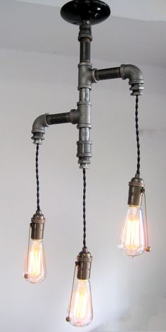 The Original- Industrial edison tiered trio pipe chandelier. $399.00, via Etsy.