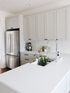 great modern country farmhouse kitchen, but could use some colour, maybe paint walls, love the spout and sink, could route quartz counter as drainboard