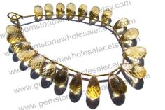 https://www.etsy.com/in-en/listing/186281535/citrine-faceted-drops-quality-a-18-cm-18?ref=shop_home_active_6&ga_search_query=Citrine