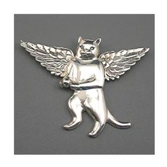 For the cat lover, this sweet silvertone angel cat brooch is the purrfect piece! It is a larger piece of jewelry, measuring 3-1/4 wide at
