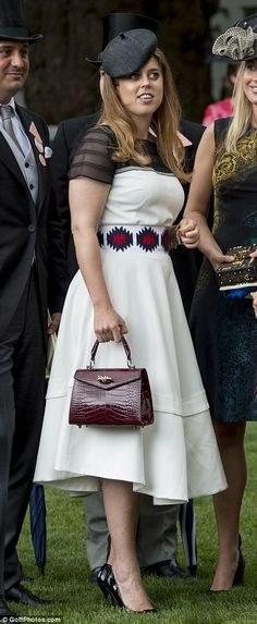 Stepping out: Princess Beatrice made an appearance in a monochrome dress paired with a bur...