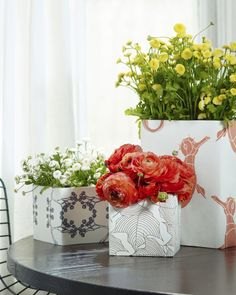 6 Unexpected Uses For Wallpaper When wrapped in wallpaper, basic glass vases take on a totally new look.
