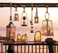 Several lanterns hung at varying heights from a wooden ladder (saw this at Pottery Barn). Patio Lanterns, Hanging Lanterns, Candle Lanterns, Hurricane Lamps, Ideas Lanterns, Lanterns Decor, Hanging Lights, Decorative Lanterns, Hanging Jars