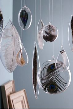 Feather ornaments! So beautiful! I am pretty sure I could make these...
