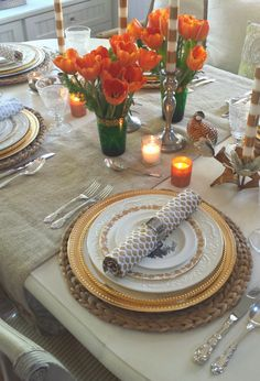 Heirloom china, gold accents and orange tulips were the inspirations this year for my Thanksgiving table.