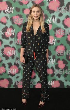 Bed-chic: Elizabeth Olsen rocked a stylish silk pyjama suit at the launch for Kenzo x H&M in New York on Wednesday