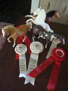 Breyer horses & show ribbons  Hmm, the Alabaster Fighting stallion looks chalky! Beautiful <3