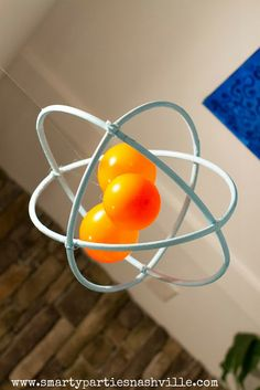 """Atomic"" mobile made from hula hoops, zip ties, and balloons! Smarty Parties: Smart and Sassy Science Party"