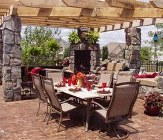 poolside pergola- love the rock and fireplace!