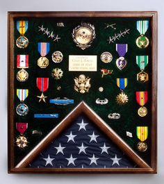 Going to try and do something along this idea for all of the boys (or most of) his hockey medals. Minus the flag part. Trophy Display, Award Display, Flag Display Case, Coin Display, Military Retirement Parties, Army Medals, Military Shadow Box, Military Awards, Army Party
