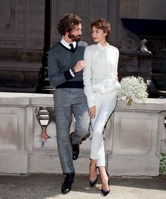 Brides.com: City Hall Wedding Dresses. On her: Jacket, $1,716, Peter Som, available at 25 Park. Blouse, $674, and pants, $685, Peter Som, available at Bergdorf Goodman. Pumps, $920, Gianvito Rossi, available at Barneys. Diamond studs, $4,650, Greenwich Collection. Cuff links, $175, Robert Talbott. On him: Sweater, $495, shirt, $195, and trousers (part of a suit), $1,375, Black Fleece, Brooks Brothers. Tie, $95, Ports 1961. Boots, $895, Jimmy Choo. Watch, $1,750, Baume & Mercier. Band, $825…
