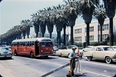 A rare and remarkable image of cars passing by Hollywood High on Sunset Blvd during the 50s!