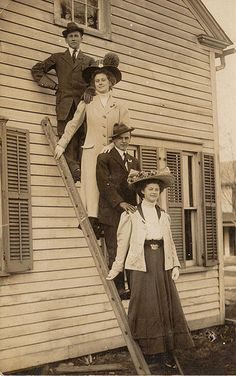 Date unknown  Ladder pose.   Anyone else notice the face in the window?