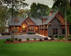 Cottage at the Lake - traditional - exterior - charlotte - McSpadden Custom Homes; love, the rust-colored wood; and, the drive-right-past the front door, to the garage! Log Homes Exterior, Dream House Exterior, Dream House Plans, Exterior Design, Rustic House Plans, Exterior Paint, Dream Home Design, My Dream Home, House Design