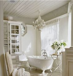 claw foot tub and chandelier