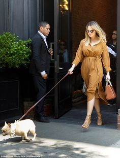 Follow me:Pampered pooch Pippa lead the way as her trio of humans left for the aiport...