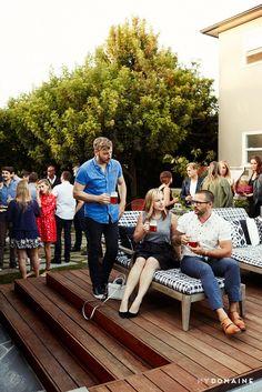 Mingling guests at Meritt Elliott and John Rankin's backyard dinner party