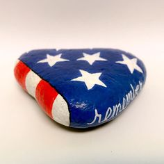 """Painting rocks or easy painted rock ideas with positive messages is something I love to do! Hand painted river rocks in various themes, colors, patterns and positive sayings. Perfect for gifts or to """"artfully abandon"""" to brighten someone's day. Flag Painting, Pebble Painting, Pebble Art, Stone Painting, Folded Flag, Painted River Rocks, Painted Stones, Inspirational Rocks, We Will Rock You"""