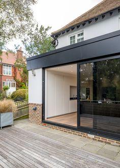 Modern flat roof extension open plan living timber for Sliding glass doors extension