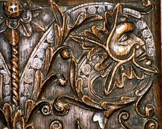 There are 4 carvings on this cupboard door at Stanton in the Cotswolds. Two are Green men in profile; two are Green animals.