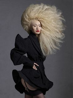 A long blonde straight quirky avant garde coloured frizzy frizzed hairstyle by Steven Carey