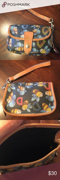 Dooney and Burke Bumble Bee Flap Wristlet Used Dooney and Burke Bumble Bee flap wristlet. It also has leather trim and a detachable wrist strap. This pattern has been retired by Dooney and Burke. It was originally purchased from a department store. Comes from a smoke free home. Dooney & Bourke Bags Clutches & Wristlets