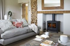 White and wood! Love the log stack and recycled wood coffee table. (EasyLiving.co.uk)