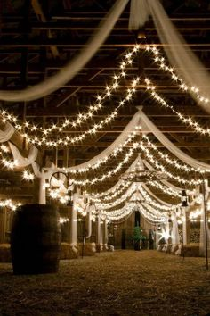 barn wedding reception ideas with draping fabric and lighting #wedding #weddingideas #barnwedding