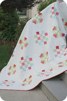 Georgia pattern. 16 patch + simple applique.  Plus, the colors are lovely.