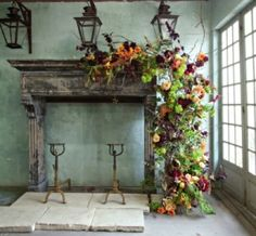 """An """"over the top"""" arrangement of branches, berries, produce, and assorted flowers makes a bold statement draped across the mantle. [Fall 2011, Department: Design School, Floral Design: Johnathan Andrew Sage"""