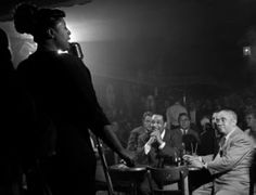 Herman Leonard - Ella Fitzgerald at her 31st birthday party in 1948