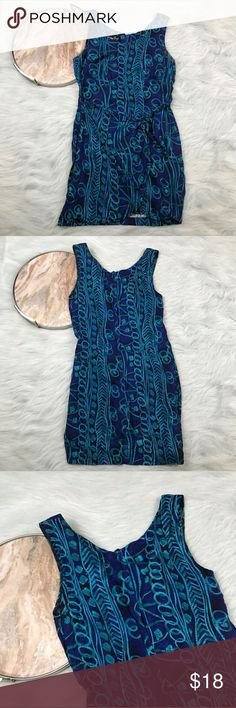 "Vtg 90s All That Jazz Hawaiian Mini Dress All That Jazz blue wrap dress Womens Size small, gently used with no flaws. Please see photos for exact details.    Armpit to armpit- 18""  Waist laying flat-15""  Length- 34""   Inventory U19 All That Jazz Dresses"