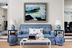 Styled by StacyStyle for @New England Home. Photo by Sam Gray. Blue and white living room.