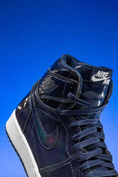 Back in 2015, Dover Street Market collaborated with Jordan Brand on the Air Jordan 1 High in an all-navy patent leather colorway. One of the most opulent looks ever for the retro basketball shoe, the design features a unique iridescent rainbow effect.