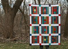Reverse values - dark blocks with light sashing, Kaffe Fassett stripes. Wonder how strips of his florals would work?