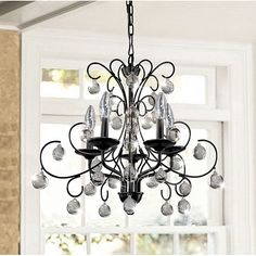 Finished in gorgeous black, this chandelier is a great addition to any lighting design. The chandelier base is constructed of sturdy iron to ensure a long lasting illuminating centerpiece for your decor. 5 Light Chandelier, Antique Chandelier, Modern Chandelier, Chandelier Ideas, Restaurant Concept, Iron Chandeliers, Home Decor Outlet, Wrought Iron, Lighting Design