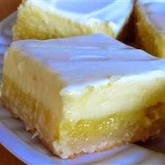Cheesecake Lemon Bars ~ A light lemony cheesecake dessert that makes two layers, one lemony layer, and another cheesecake layer. You'll be coming back for more..!,,