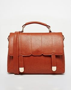 I like the scalloping and stitching details on this tan Asos bag.