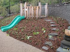 Embankment slide with timber platform, groundcover planting and stone . May Embankment slide with timber platform, groundcover planting and stone . - -May Embankment slide with timber platform, groundcover planting and stone .