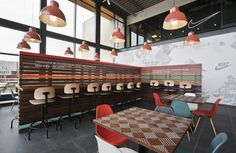 Re-designing Nike's corporate canteen must have been a challenging task. Nike EMEA chose Amsterdam-based studio UXUS to join their design team and compose Cafeteria Design, Commercial Design, Commercial Interiors, Visual Merchandising, Amsterdam, Timber Slats, Pub, Traditional Interior, Colorful Chairs