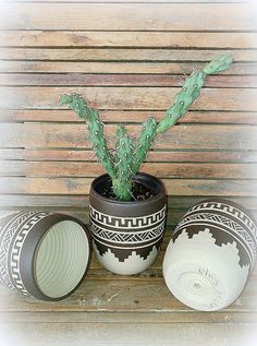 I throw these vase on the wheel, then colored it with black slip, carved Accuracy by hand and fired at a temperature of 1200 º C to ensure its durability.  My inspiration for this vase came from the native america calture which I adore :)  Each vase get full Investment and get this unique look.  ►listing is for 1 planter(the one in the middle) ►Contains small hole in the bottom for drainage ►you will get the planter without the succulent :)  Vase measures (cm) 11 cm high 9cm in diameter…