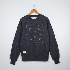 Idioma Ltd  Paper Planes Organic Crewneck Sweatshirt : This one is in honour of one of the simplest forms of Origami, one we all know. Its debated whether the Chinese or the Japanese first created the Paper Aeroplane so without offending either party we've the text Kami Hikoki or how we would say the Japanese for Paper plane and below in Kanji or Hànzì a script used and understood by both the Japanese and the Chinese.  Organic crewneck unisex sweatshirt made in a Fairwear Factory. Designed…