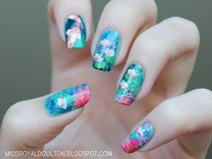 """Monet's """"Water Lilies"""" with koi fish nail art"""