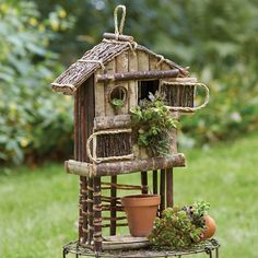Unique Tall Birdie Dwelling Condo Birdhouse Garden Bird Houses   Crafted from twigs and other natural materials, this decorative bird condo can be hung from a tree or placed in a flower bed.   The perfect digs for aspirational birds  MEASUREMENTS:  6 Inch Width x 6.5 Inch Depth x 24 Inch Height.