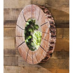Found it at Wayfair - Faux Tree Section and Bark Wooden Mirror
