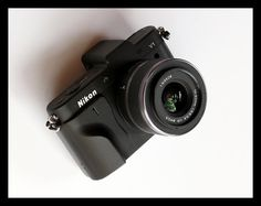 Snazzy custom grips for Nikon's V1 mirrorless camera.