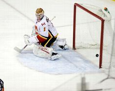 Calgary Flames goalie Brian Elliott (1) watches the puck get past him for a goal by New York Rangers' Chris Kreider during the third period of an NHL hockey game Sunday, Feb. 5, 2017, in New York. (AP Photo/Frank Franklin II)