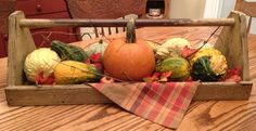 fill an old tool caddy with colorful gourds and pumpkins, add some grapevine and fake leaves