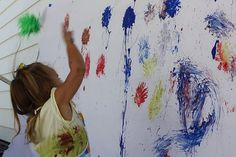 painting with a spiky rubber ball - messy fun!