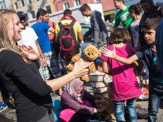 An employee of the initiative 'Refugee help Munich' hands out plushies to refugee children, at Munich's central train station, in Munich, Germany, 01 September 2015. H